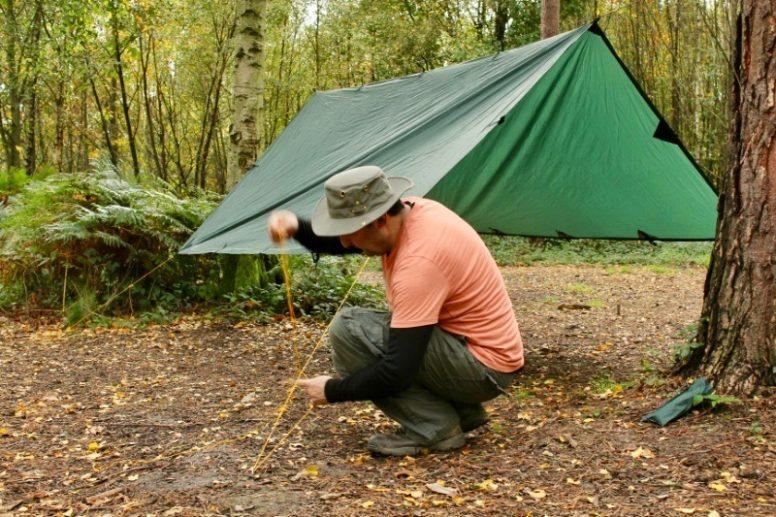 Hammock camper Jon Silver setting up his hammock - photo by Sini Manner