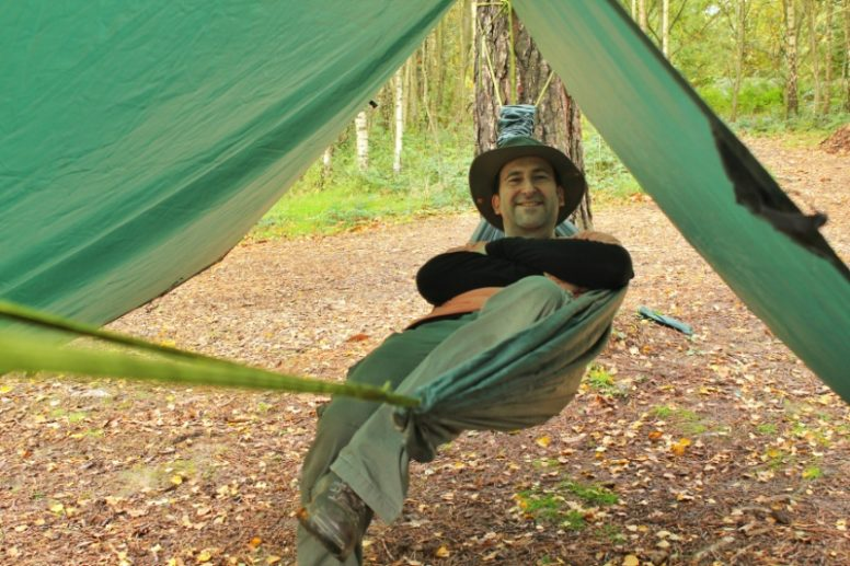 Jon in his hammock, wild camping at The Secret Campsite Beech Estate. Photo by Sini Manner.