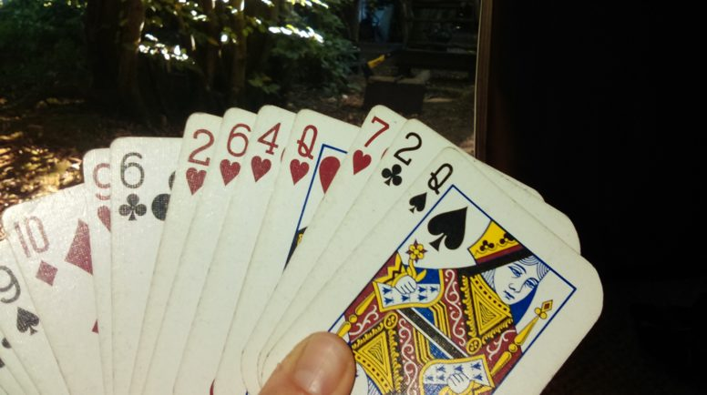 A hand of playing cards - but not all camping games for kids need equipment