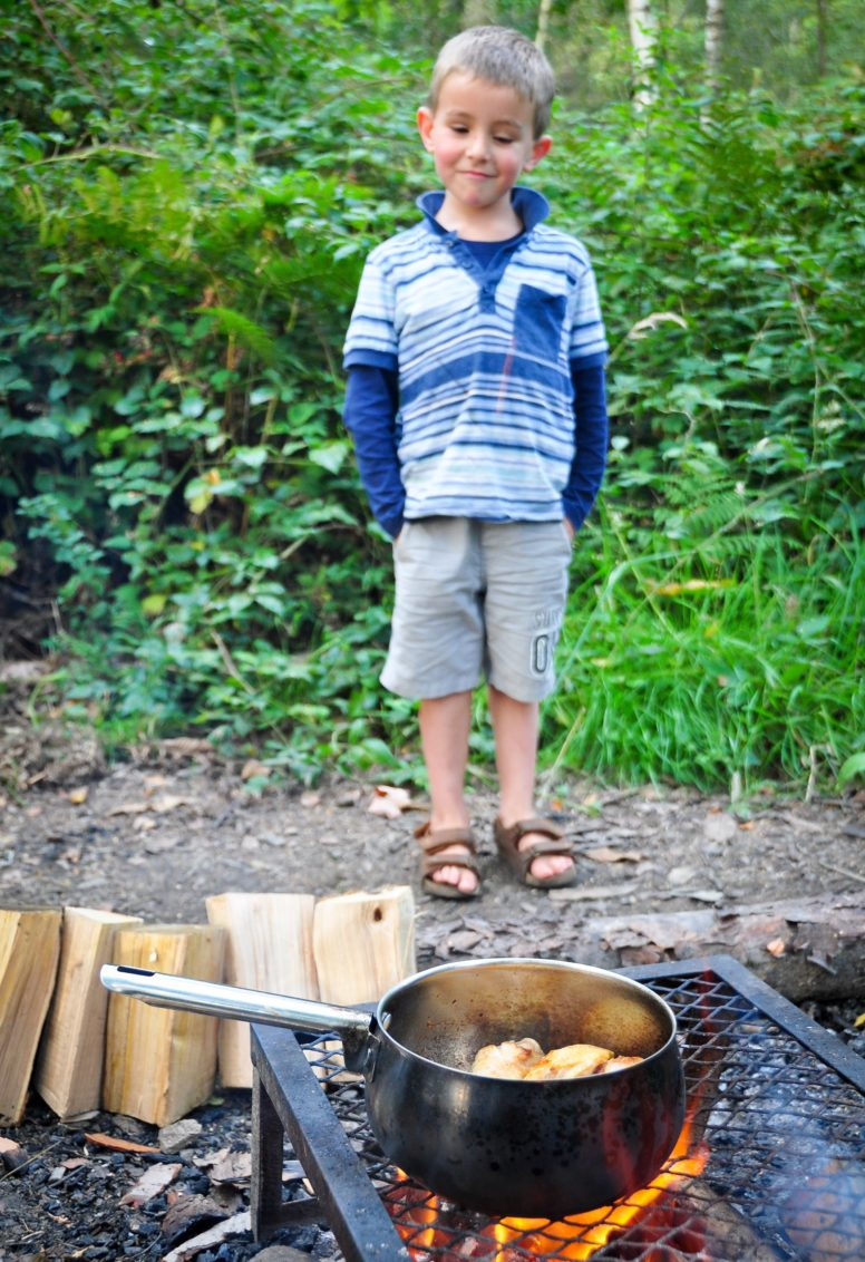 Cooking on a campfire at Beech Estate in Sussex