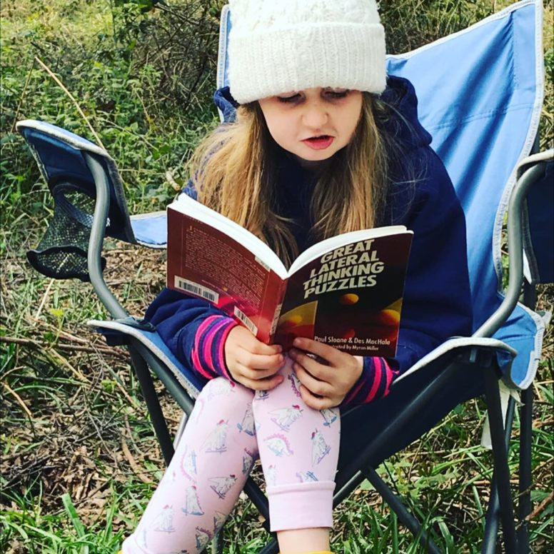 Rainy day reading at the campsite