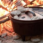 Dutch oven cooking on campfire in Sussex Campsite