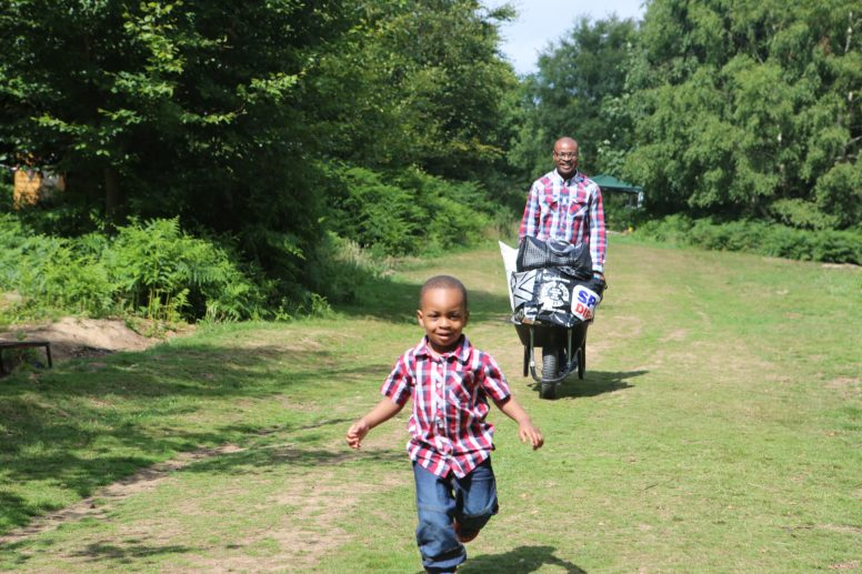 A dad and son arriving at The Secret Campsite Beech Estate for a Sussex family camping weekend