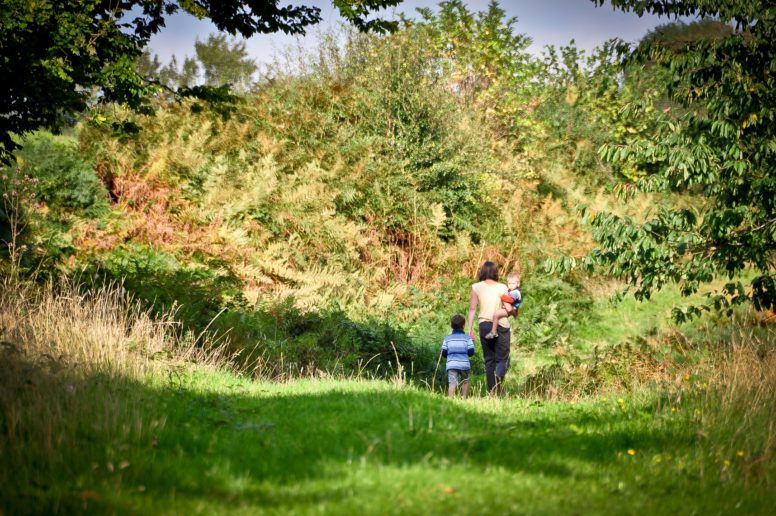 A mum and two kids walking at The Secret Campsite Beech Estate