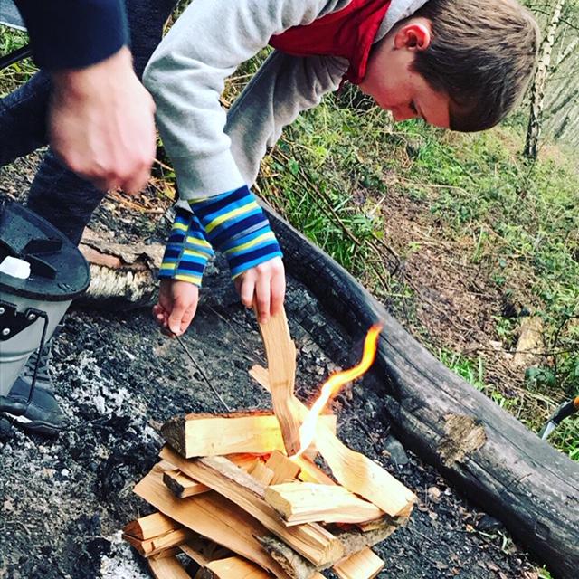 Building a campfire at Beech Estate Campsite