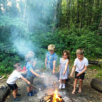 Children toasting marshmallows at Beech Estate Campsite in Sussex