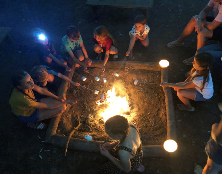 Group Camping - kids toasting marshmallows