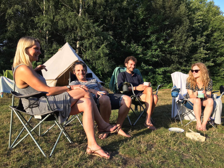 Adults unplugging at Beech Estate Campsite