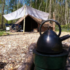 Bell tent and fire at Sussex Campsite, Beech Estate