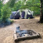 Tents and campfire at campsite in Sussex