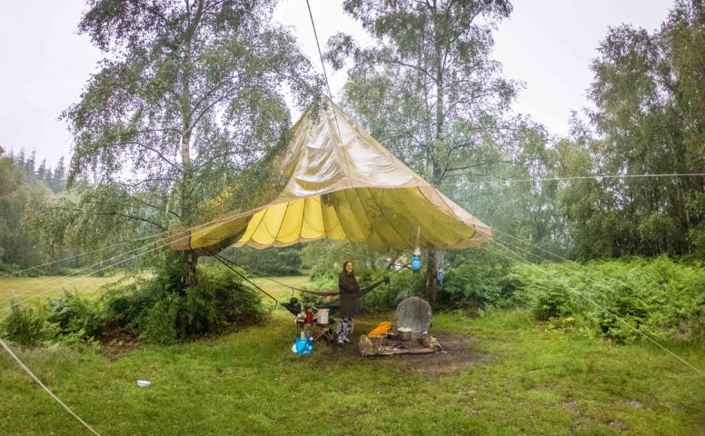 Parachute shelter when camping in the rain