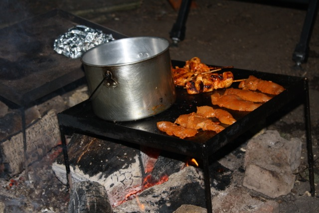 Cooking on the campfire at Wild Boar Wood Campsite in Sussex