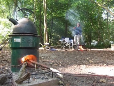 Heating the kettle at the campsite with campfires