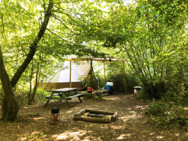 bell tent camping in the woods