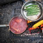 Campfire cooking on the grill as Sussex glamping site