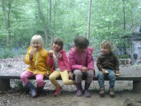 Sussex family glamping - Children on the bench at The Secret Campsite Wild Boar Wood