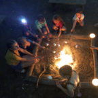Toasting marshmallows on the communal campfire at Wild Boar Wood Campsite