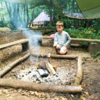 Child toasting marshmallows at family glamping site in Sussex