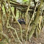 Children building a den at Sussex glampsite