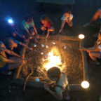 Children toasting marshmallows on the campfire